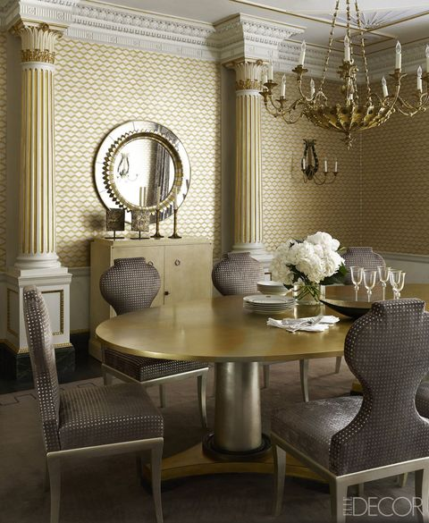 """In this Manhattan townhouse, designed by Anne Pyne, the dining room is swathed in rich gold wallpaper and accented with even more gilded accents, from the dining room table to the chandelier.  <a target=""""_blank"""" href=""""http://www.elledecor.com/design-decorate/house-interiors/g110/manhattan-townhouse-design-opulent-anne-pyne/"""">Tour the rest of the home</a>."""