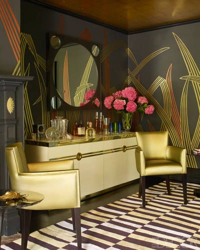 """In this home bar, the wallpaper picks up on the matte gold sitting chairs to bring unexpected glamour to an otherwise refined house.  <a target=""""_blank"""" href=""""http://www.elledecor.com/design-decorate/house-interiors/g2332/rural-refinement/"""">Tour the rest of the home</a>."""