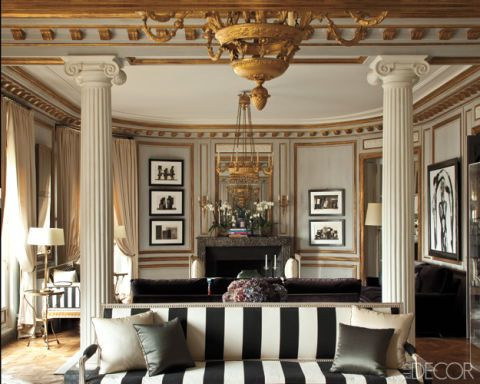 """The living room of a Paris apartment decorated by Frédéric Méchiche features ornate wall detailing coated in a rich, metallic brass.  <a target=""""_blank"""" href=""""http://www.elledecor.com/design-decorate/house-interiors/g1155/the-gilded-age/"""">Tour the rest of the home</a>."""