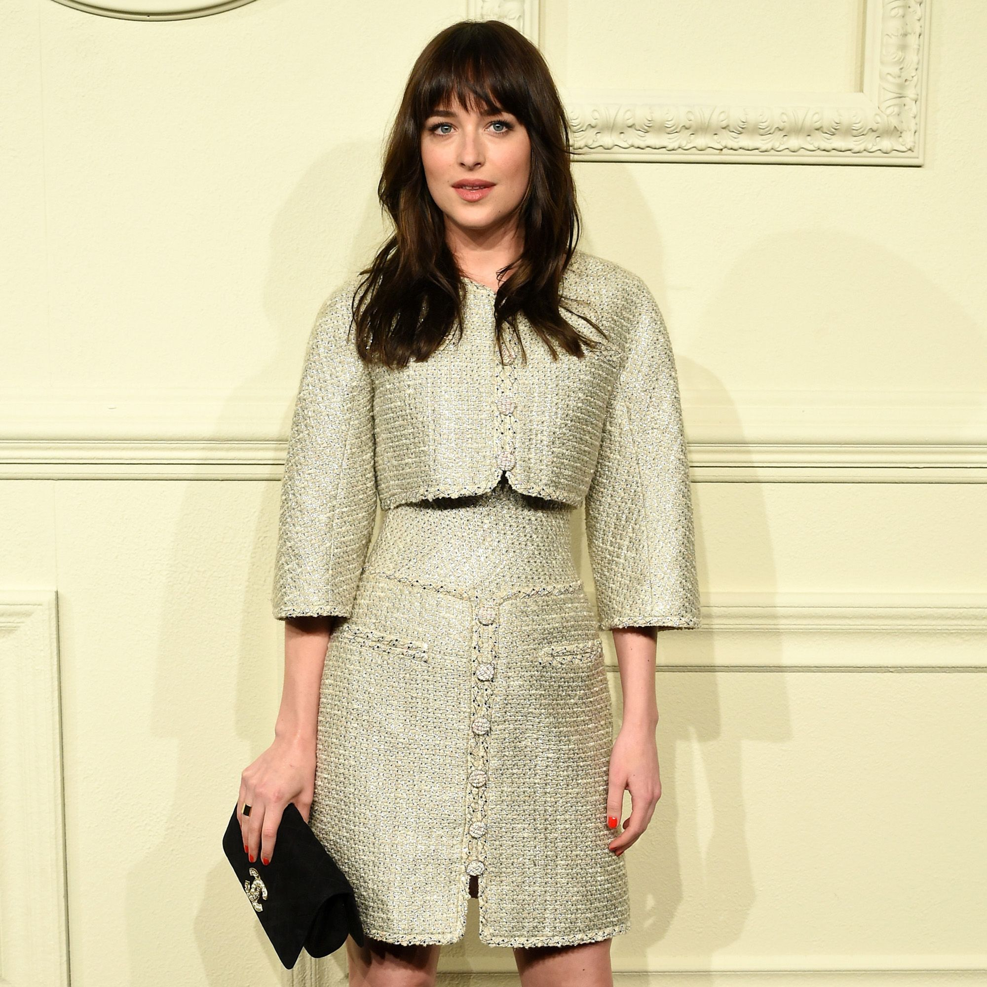 NEW YORK, NY - MARCH 31:  Actress Dakota Johnson attends the CHANEL Paris-Salzburg 2014/15 Metiers d'Art Collection in New York City at the Park Avenue Armory on March 31, 2015 in New York City.  (Photo by Andrew H. Walker/WireImage)