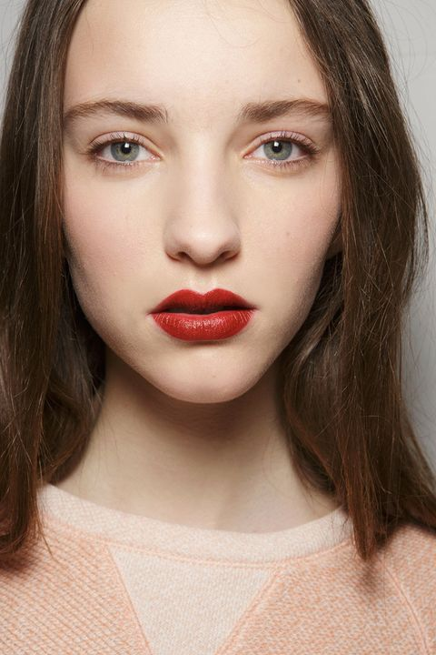 Red lipstick doesn't sound all that revolutionary, but when it goes away for a few seasons in favor of clear balms and nude tints, then makes its comeback in big, not-so-expected ways on the fall runways, well, it's what we needed to get us excited about the makeup bag staple all over again. At 3.1 Philip Lim (left), makeup artist Francelle Daly looked to her '90s-era Doc Martens to inspire the brick-red shade, while Dolce & Gabbana and Marchesa went moodier than usual with their takes on the trend.