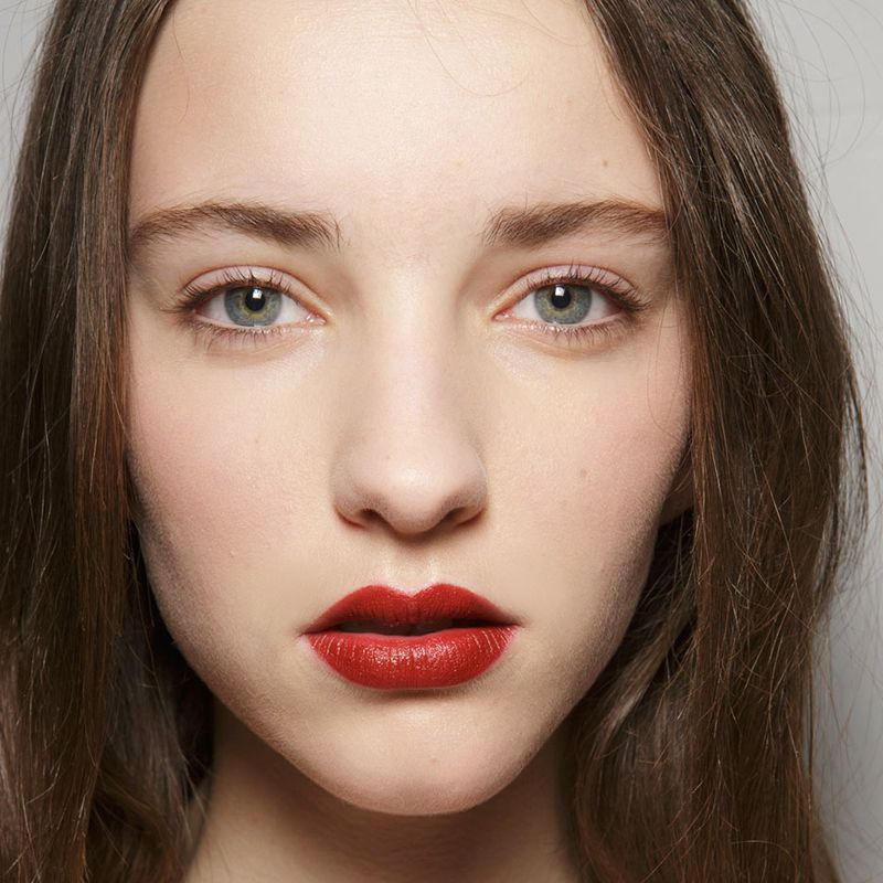 Red lipstick doesn't sound all that revolutionary, but when it goes away for a few seasons in favor of clear balms and nude tints, then makes its comeback in big, not-so-expected ways on the fall runways, well, it's what we needed to get us excited about the makeup bag staple all over again. At 3.1 Philip Lim (left), makeup artist Francelle Daly looked to her '90s-era Doc Martens to inspire the brick-red shade, while Dolce &amp&#x3B; Gabbana and Marchesa went moodier than usual with their takes on the trend.