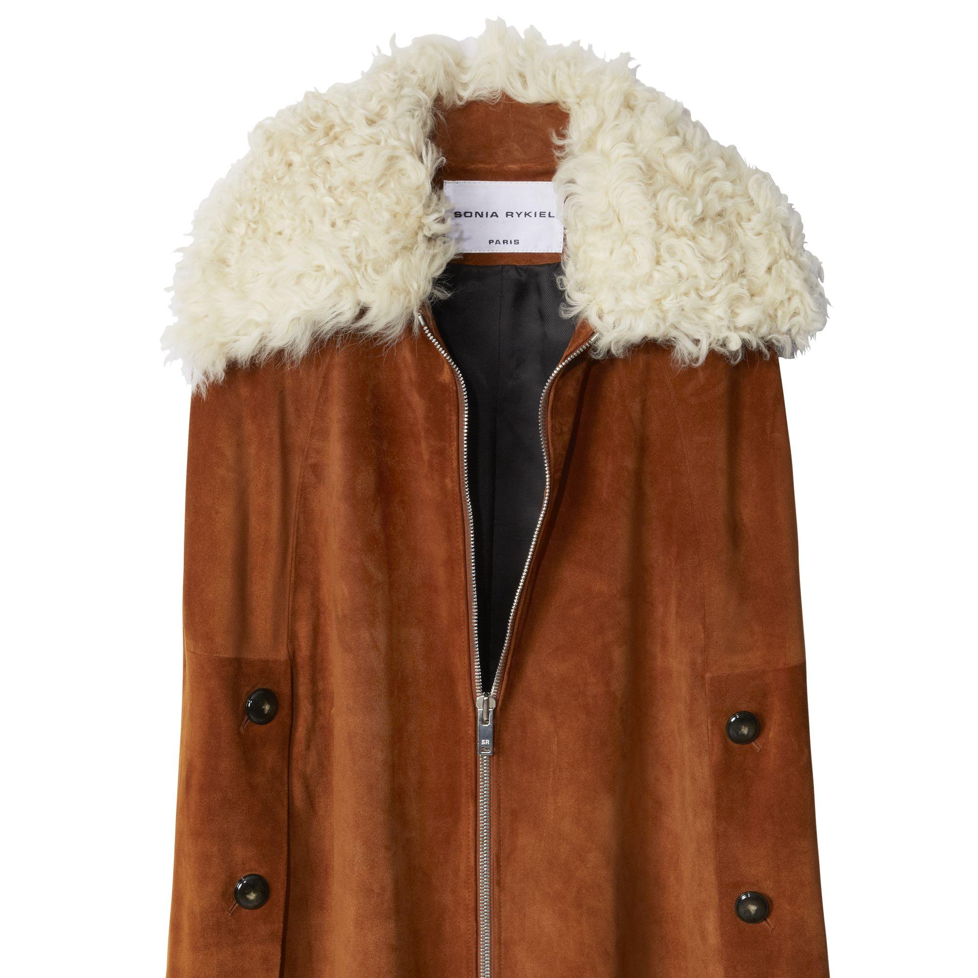 "<strong>Sonia Rykiel</strong> cape, $3,290, <a target=""_blank"" href=""http://shop.harpersbazaar.com/designers/sonia-rykiel/suede-shearling-cape/"">shopBAZAAR.com</a><img src=""http://assets.hdmtools.com/images/HBZ/Shop.svg"" class=""icon shop"">."