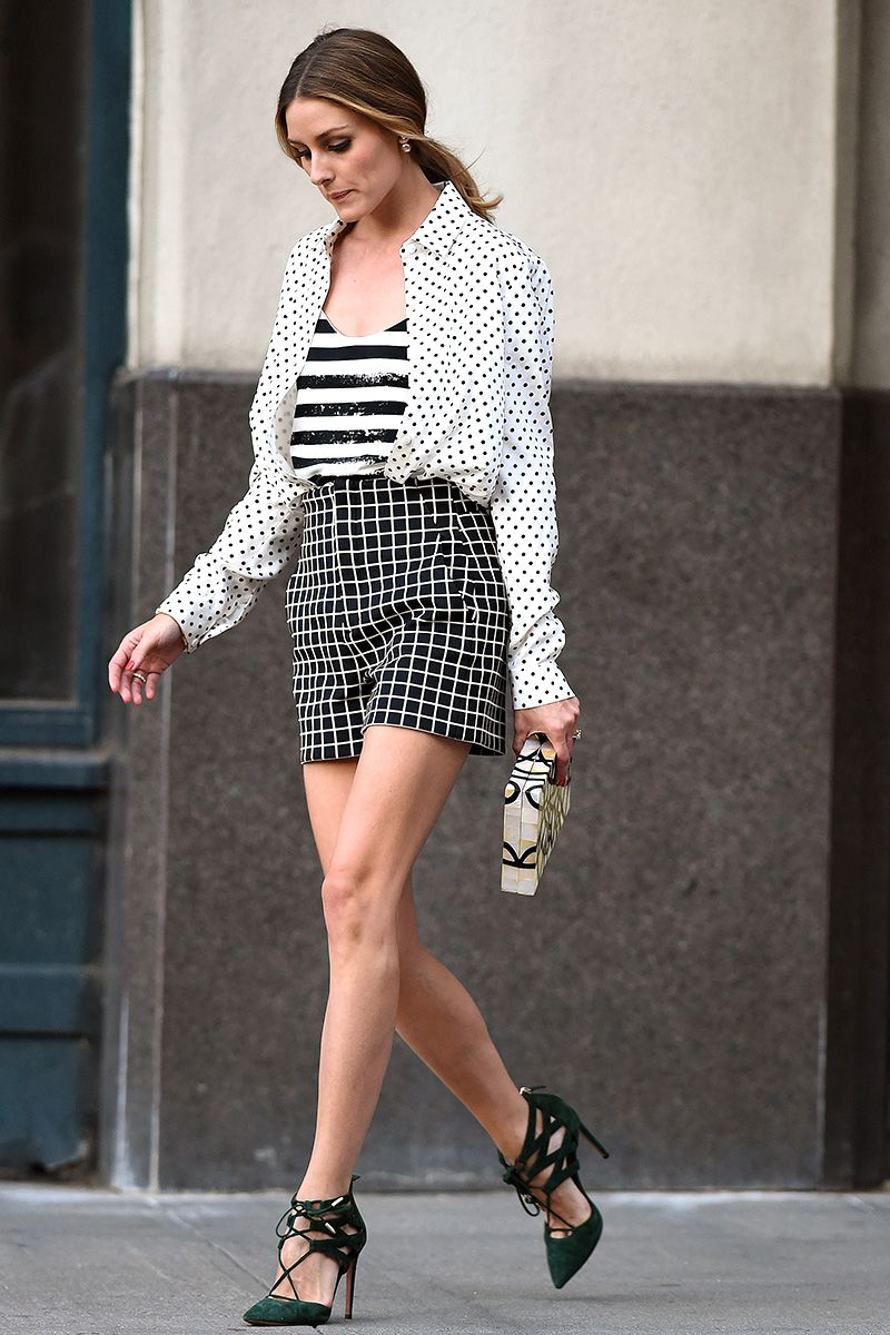 Olivia Palermo leaves her house wearing black and white patterned shorts and green suede high heels in Brooklyn, NYC.