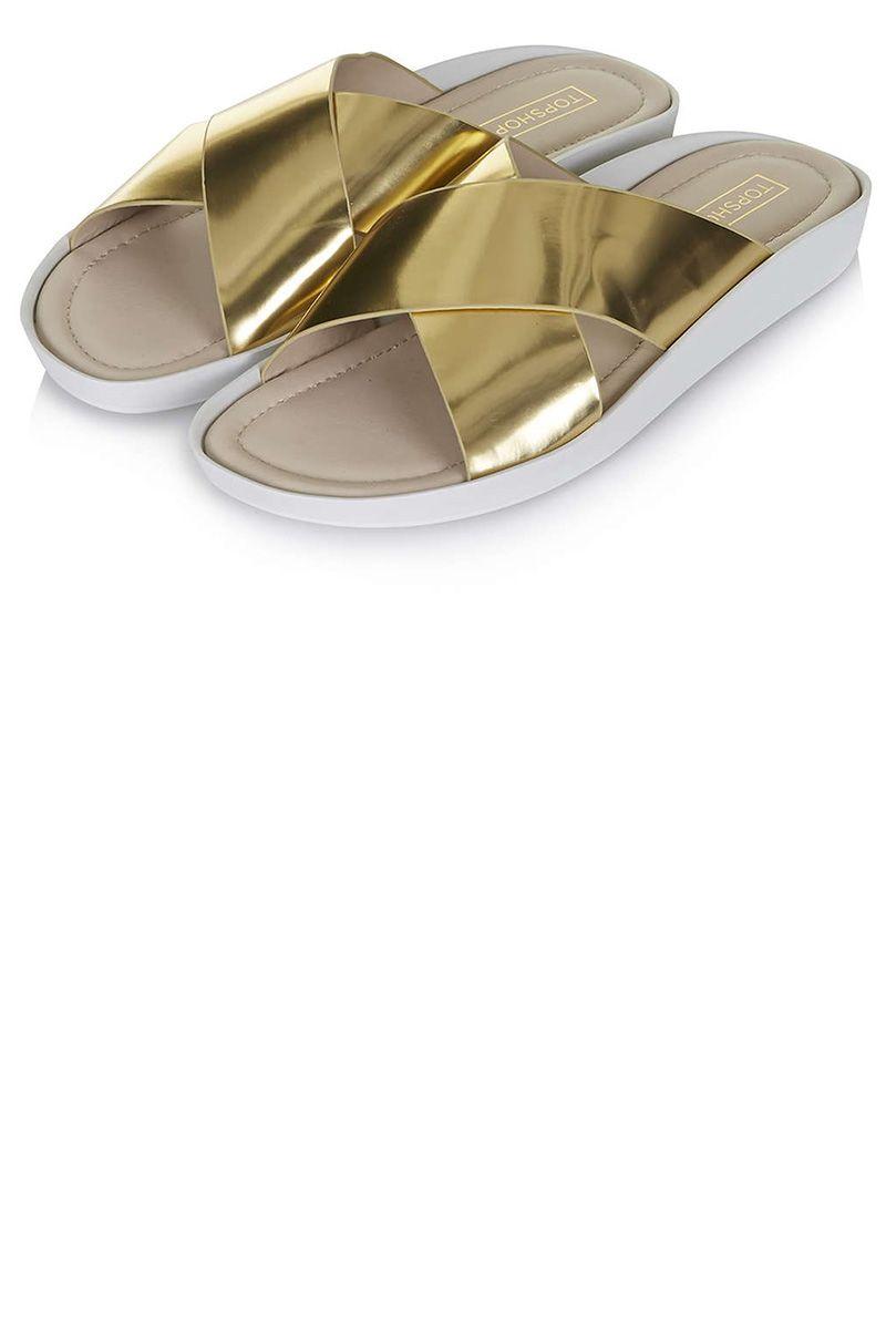 """Topshop sandals, $45, <a target=""""_blank"""" href=""""http://us.topshop.com/en/tsus/product/shoes-70484/flats-70513/hover-cross-front-pool-slides-4239914?bi=1&ps=20"""">topshop.com.</a>"""