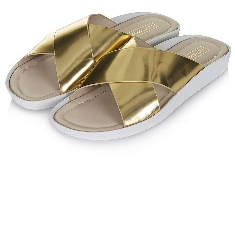 """Topshop sandals, $45, <a target=""""_blank"""" href=""""http://us.topshop.com/en/tsus/product/shoes-70484/flats-70513/hover-cross-front-pool-slides-4239914?bi=1&amp&#x3B;ps=20"""">topshop.com.</a>"""