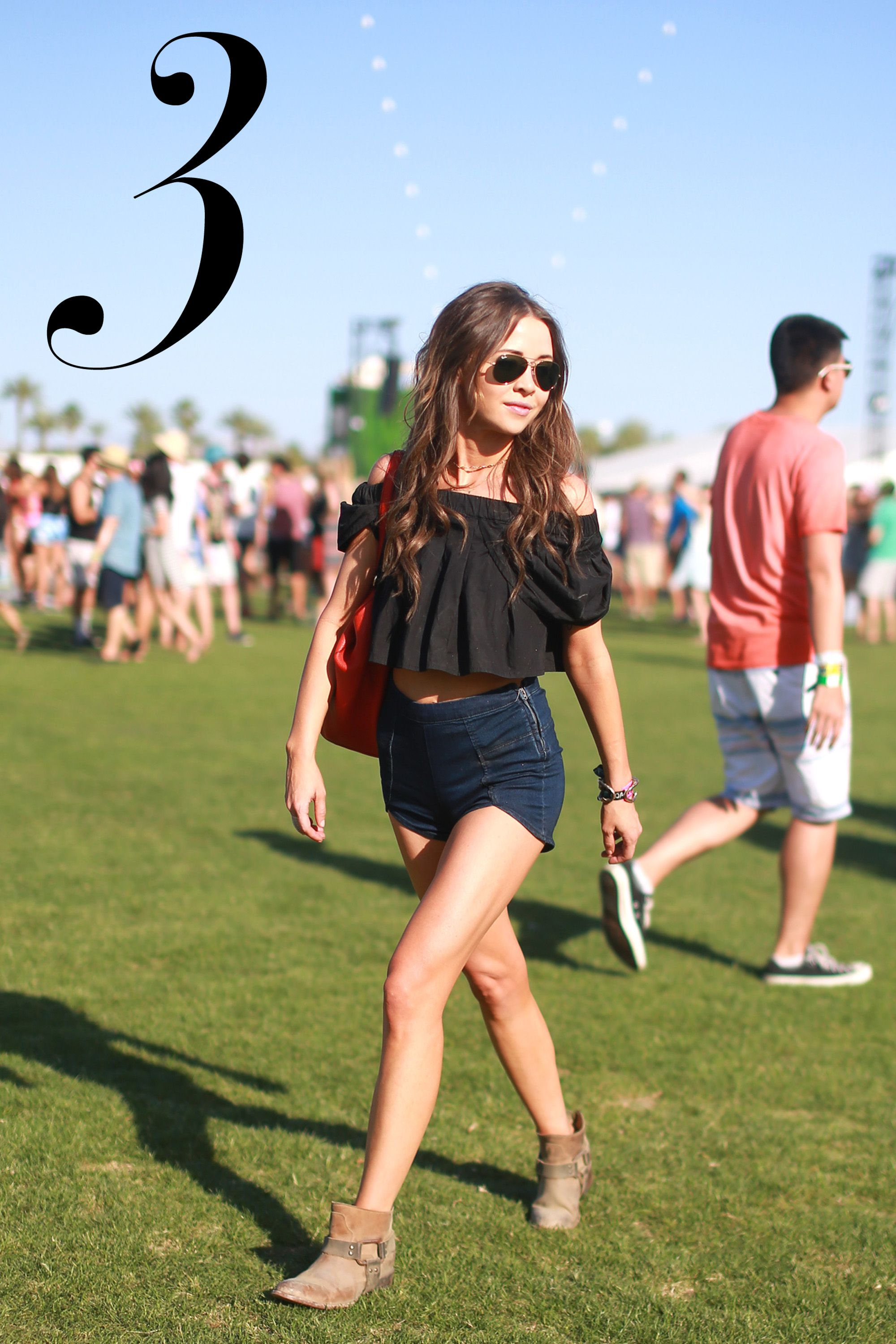 Denim shorts and a ruffled top are chic and comfortable.