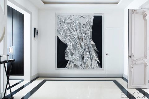 "A 2006 mixed-media work by Anselm Reyle makes quite a statement in the entrance hall of this Paris apartment.   <a target=""_blank"" href=""http://www.elledecor.com/design-decorate/house-interiors/g549/glamorous-paris-apartment-champeau-wilde/"">Tour the rest of the home</a>."