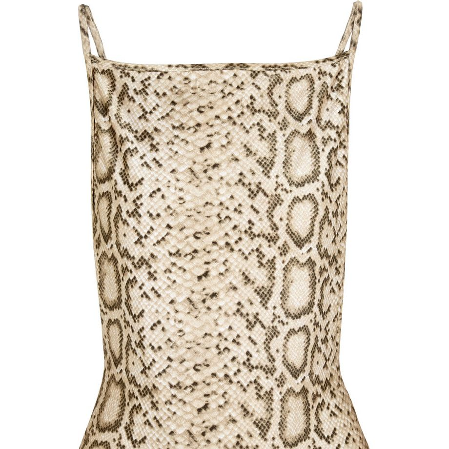 "<strong>Zimmerman</strong> swimsuit, $320, <a target=""_blank"" href=""http://www.net-a-porter.com/product/506734/Zimmermann/essence-reversible-printed-swimsuit-"">net-a-porter.com</a>."