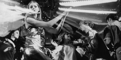 A teenage girl wearing a metallic dress dancing at a discotheque, September 1974 (Photo by Chris McHugh/Fox Photos/Getty Images)