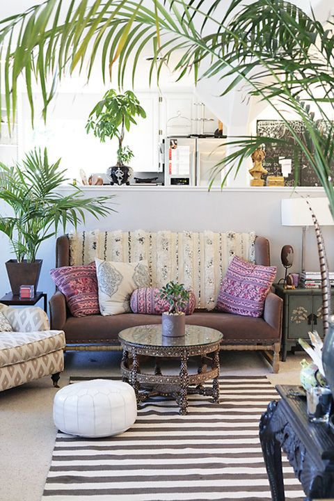 Bright Moroccan-inspired accent pillows bring a subtle boho vibe into a neutral room.