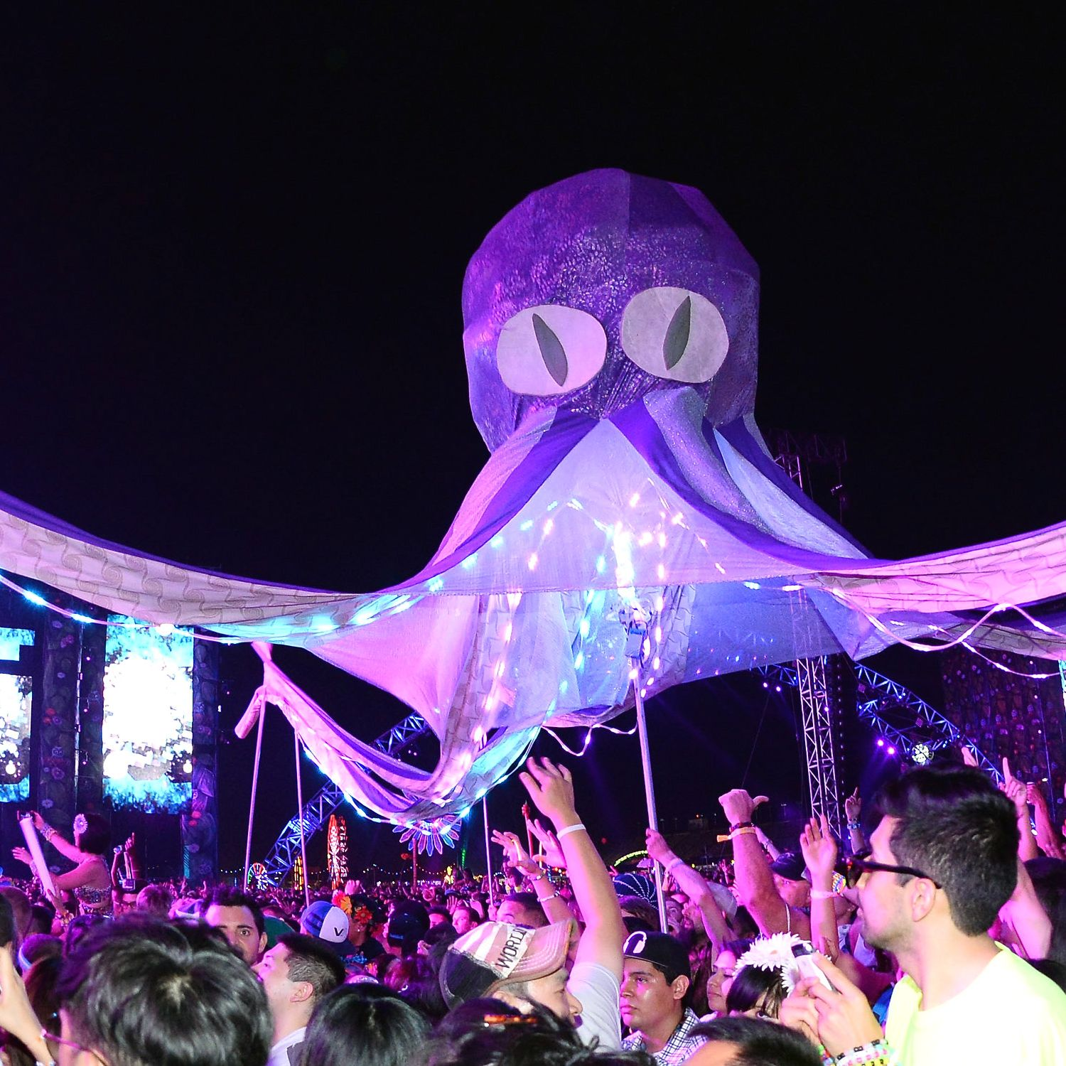 LAS VEGAS, NV - JUNE 21:  Performers carry an octopus puppet through the crowd at the 17th annual Electric Daisy Carnival at Las Vegas Motor Speedway on June 21, 2013 in Las Vegas, Nevada.  (Photo by Ethan Miller/Getty Images)
