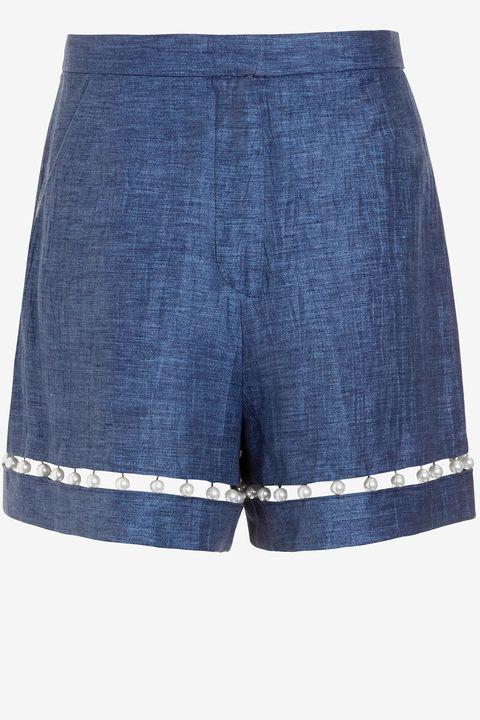 """<strong>Adam Selman</strong> shorts, $395, <a target=""""_blank"""" href=""""http://www.intermixonline.com/product/adam+selman+patootie+pearl+detail+high+waist+denim+shorts.do?sortby=ourPicks&amp;from=Search&amp;"""">intermixonline.com</a>."""