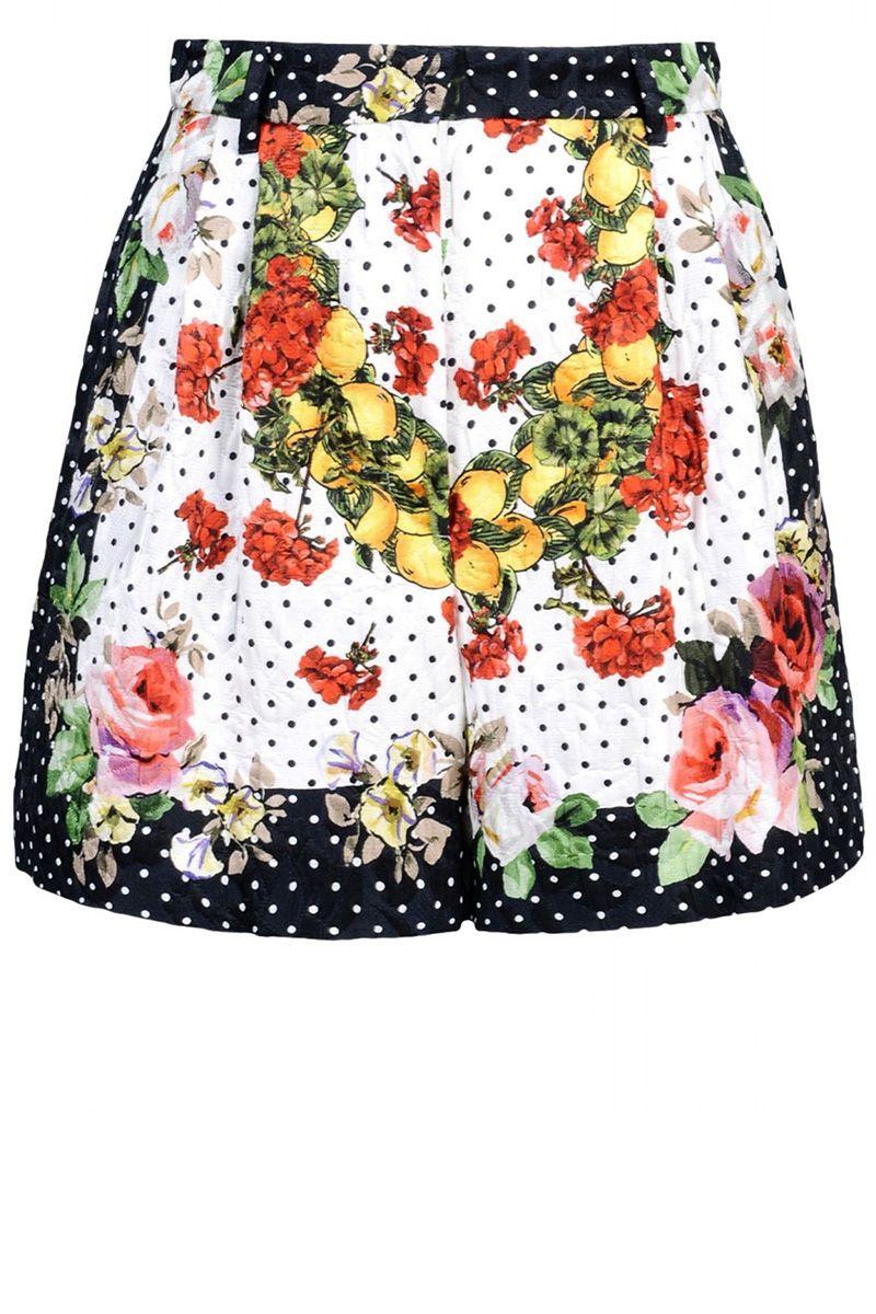 "<strong>Dolce & Gabbana </strong>shorts, $1,200, <a target=""_blank"" href=""http://shop.harpersbazaar.com/designers/dolce-gabbana/printed-shorts/"">shopBAZAAR.com</a><img src=""http://assets.hdmtools.com/images/HBZ/Shop.svg"" class=""icon shop"">."