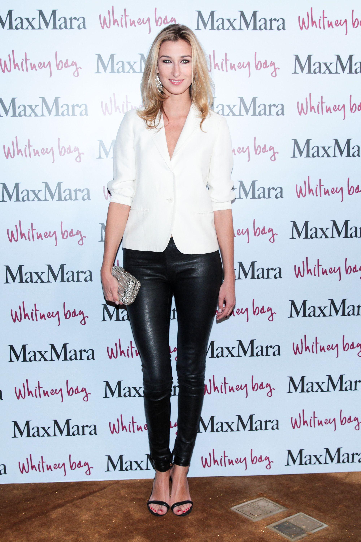 Lauren Remington Platt, (wearing Max Mara)