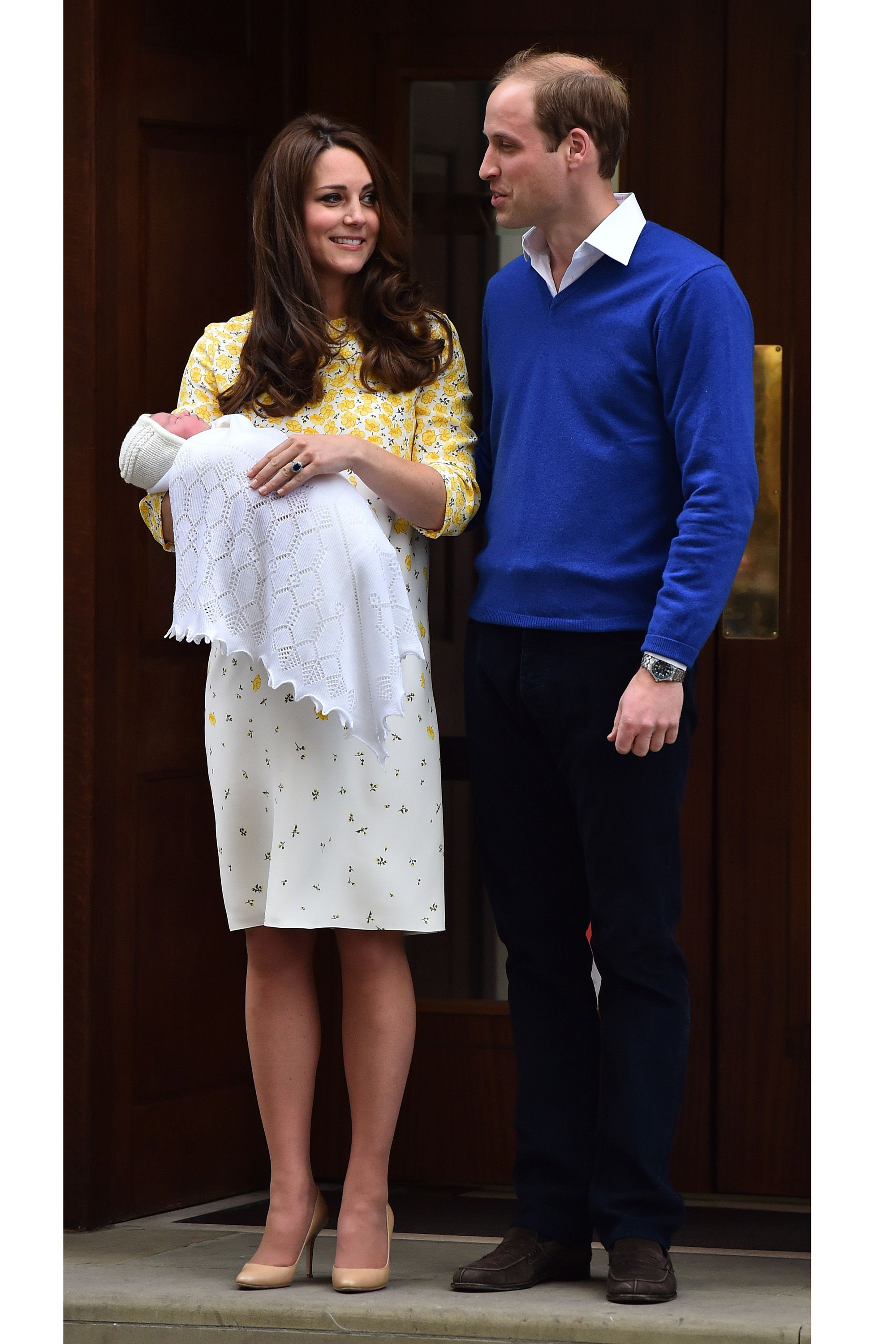 Britain's Prince William, Duke of Cambridge, and his wife Catherine, Duchess of Cambridge show their newly-born daughter, their second child, to the media outside the Lindo Wing at St Mary's Hospital in central London, on May 2, 2015.  The Duchess of Cambridge was safely delivered of a daughter weighing 8lbs 3oz, Kensington Palace announced. The newly-born Princess of Cambridge is fourth in line to the British throne. AFP PHOTO / BEN STANSALL        (Photo credit should read BEN STANSALL/AFP/Getty Images)