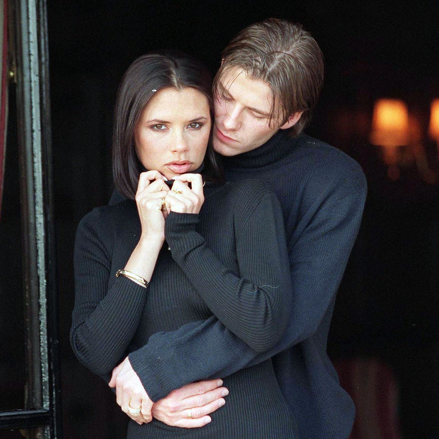 "CHESTER - JANUARY 25: British footballer David Beckham and fiance singer from the ""Spice Girls"" Victoria Adams pose for photographers outside their hotel after the announcement of their engagement on January 25, 1998 in Chester, United Kingdom. (Photo by Dave Hogan/Getty Images)"