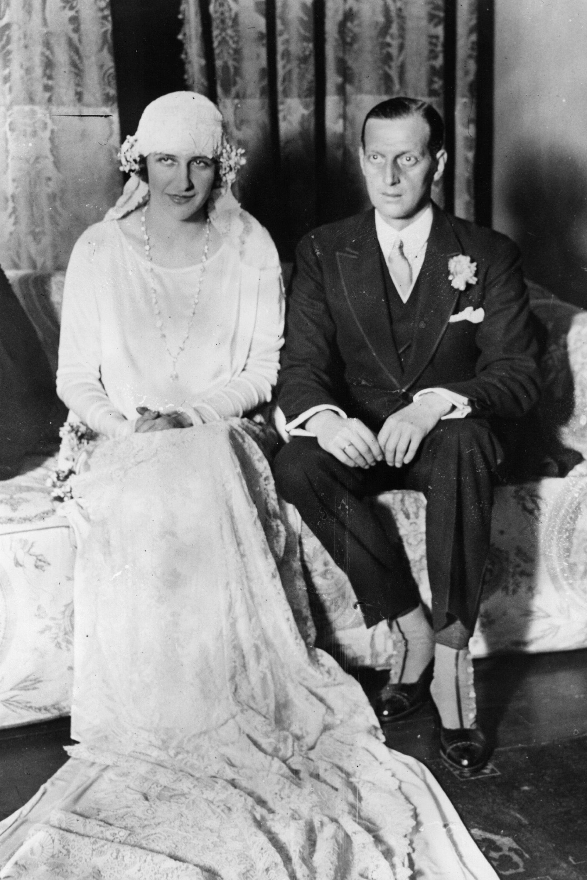 The Grand Duke of Russia,  Dmitri Pavlovitch and his bride, Audrey Emery, of New York.   (Photo by Topical Press Agency/Getty Images)