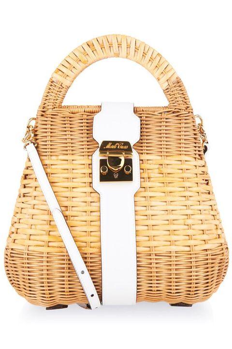 "<em>Mark Cross satchel bag, $1,854, <a target=""_blank"" href=""http://www.matchesfashion.com/us/products/Mark-Cross-Manray-small-rattan-satchel-bag-1012118"">matchesfashion.com</a>.</em>"
