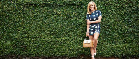 Clothing, Green, Bag, Street fashion, Knee, Hedge, Shrub, Lawn, Shoulder bag, Day dress,