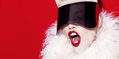 Lip, Tongue, Costume accessory, Carmine, Tooth, Fur, Costume, Lipstick, Mask, Costume hat,