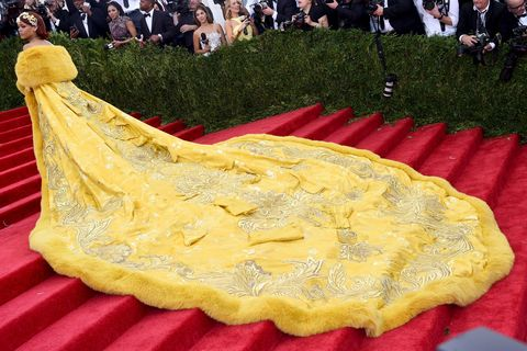 Yellow, Textile, Formal wear, Tablecloth, Crowd, Home accessories, Gown, Tradition, Carpet, Linens,
