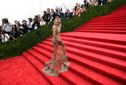 Red, Flooring, Carpet, Dress, Stairs, Gown, Red carpet, Premiere, Haute couture, Embellishment,
