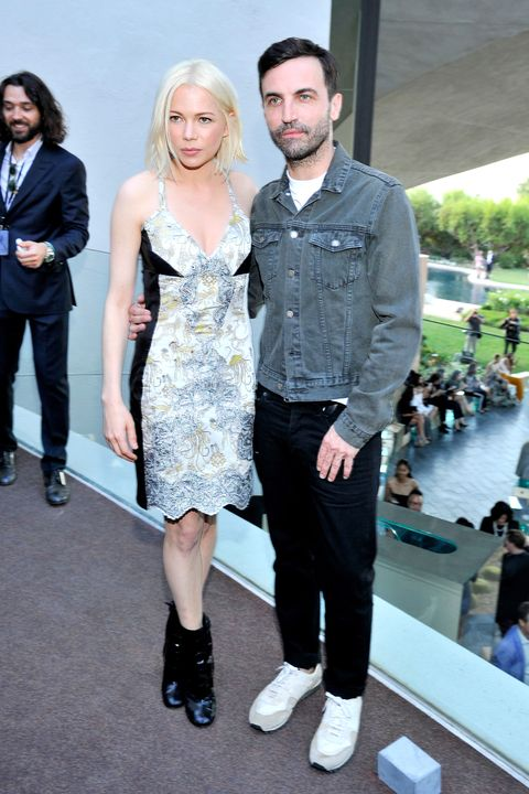 PALM SPRINGS, CA - MAY 06:  Actress Michelle Williams (L) and designer Nicolas Ghesquiere backstage at the Louis Vuitton Cruise 2016 Resort Collection shown at a private residence on May 6, 2015 in Palm Springs, California.  (Photo by Donato Sardella/Getty Images for Louis Vuitton)