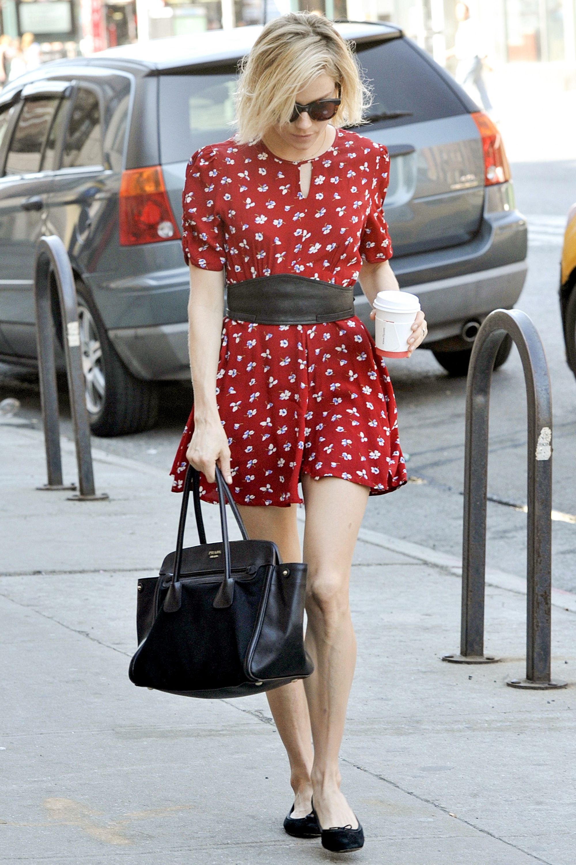 ***MANDATORY BYLINE TO READ INFPhoto.com ONLY***<BR/>Actress Sienna Miller wears a red floral print dress, which appears to have a ripped hem, as she walks in the West Village section of New York City.<P>Pictured: Sienna Miller<B>Ref: SPL1016602  040515  </B><BR/>Picture by: ACE/INFphoto.com<BR/></P><P>