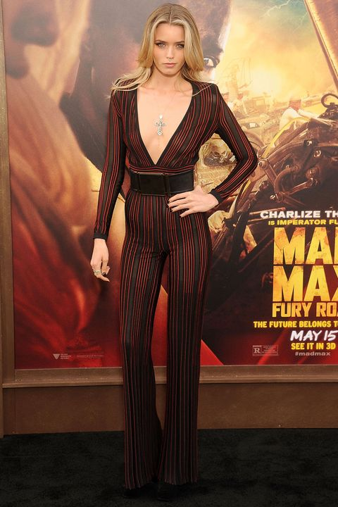 Abbey Lee Kershaw channels the current '70s mandate in a wide-leg Balmain jumpsuit, perfect for a night of dancing.