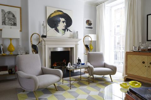 At left, a work by Lucian Freud; a Warhol print of Goethe hangs above the mantel. The chairs are by Marco Zanuso.