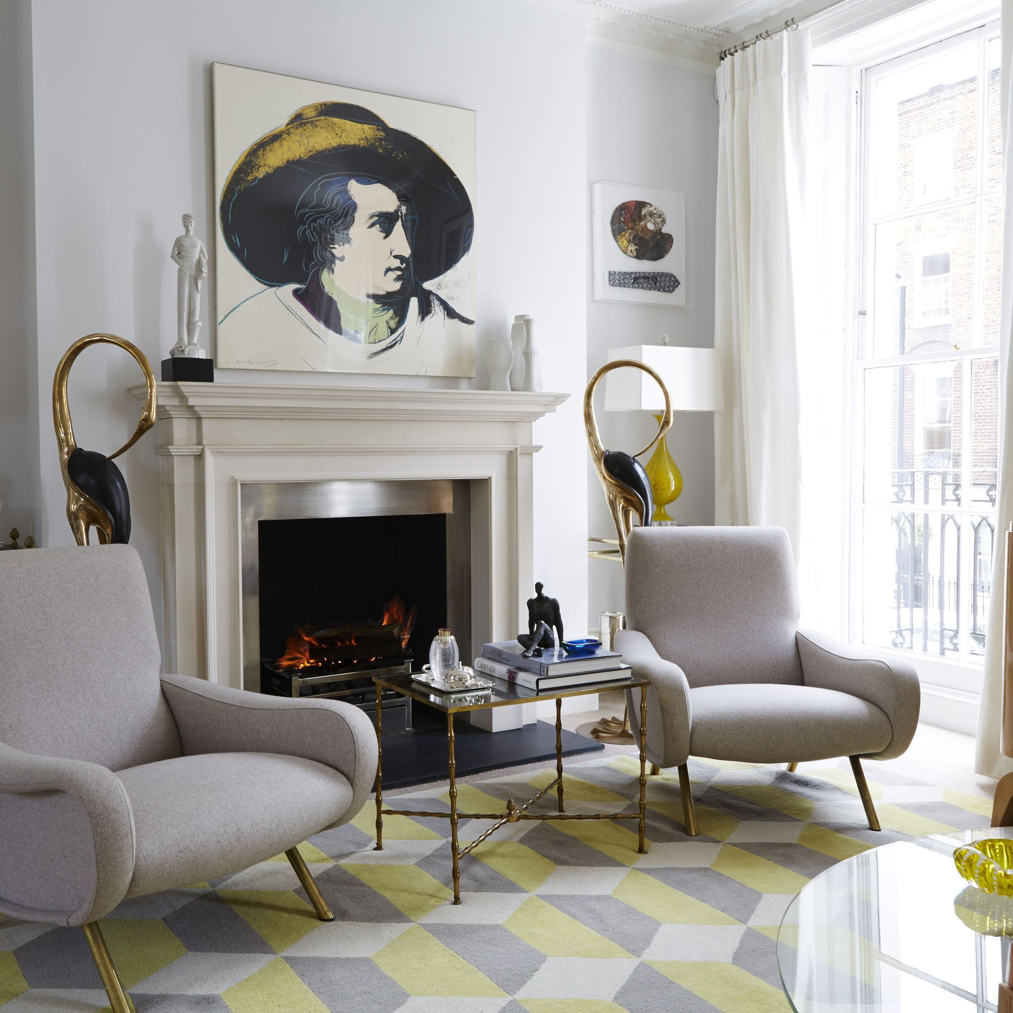 At left, a work by Lucian Freud&#x3B; a Warhol print of Goethe hangs above the mantel. The chairs are by Marco Zanuso.