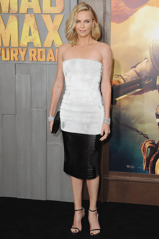 "HOLLYWOOD, CA - MAY 07:  Actress Charlize Theron arrives at the Los Angeles Premiere ""Mad Max: Fury Road"" at TCL Chinese Theatre IMAX on May 7, 2015 in Hollywood, California.  (Photo by Jon Kopaloff/FilmMagic)"