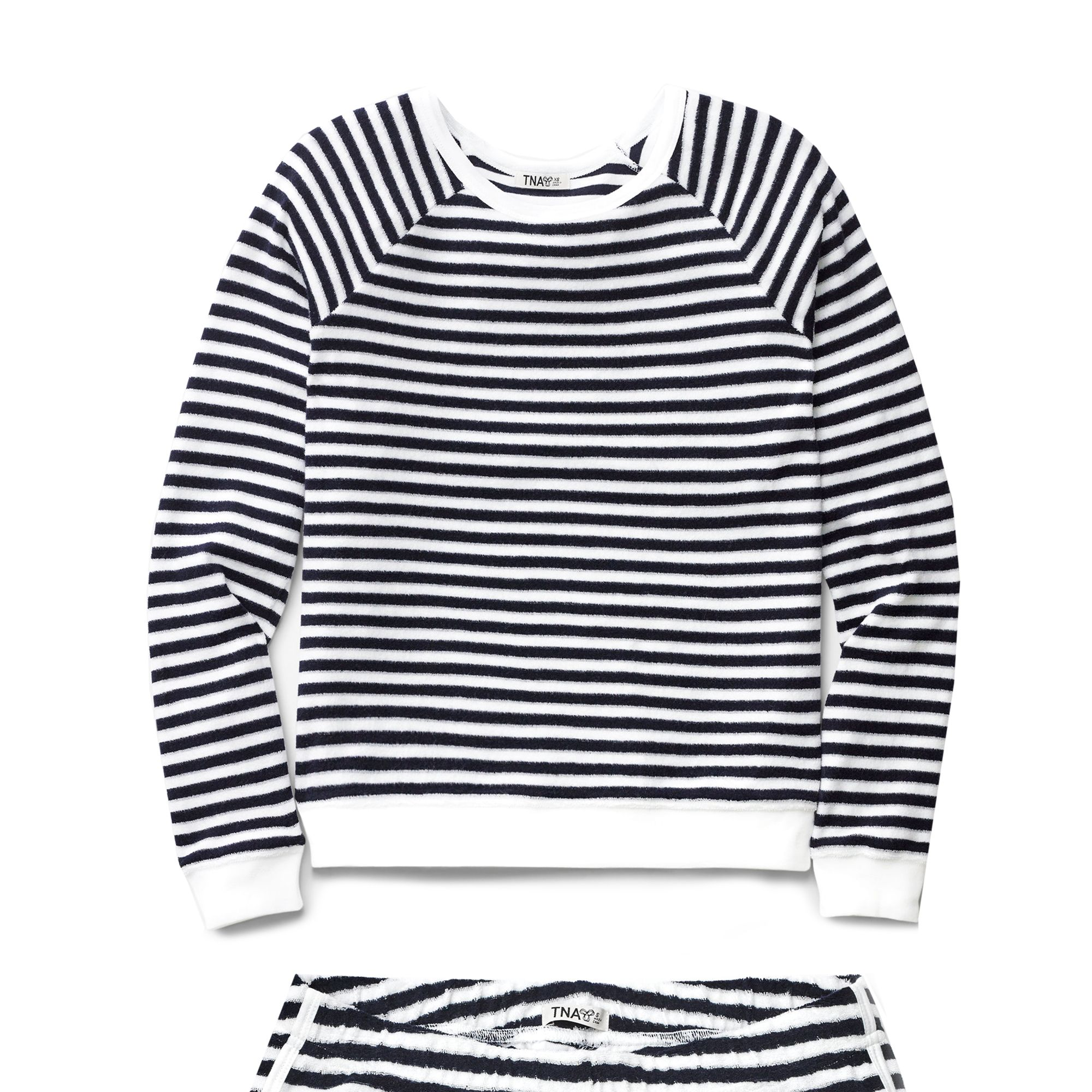 "<strong>Aritzia</strong> top, $50, <a target=""_blank"" href=""http://us.aritzia.com/product/franconia-sweater/56121.html"">aritzia.com</a>, and shorts, $40, <a target=""_blank"" href=""http://us.aritzia.com/product/yosemite-short/56449.html?dwvar_56449_color=4473#start=13"">aritzia.com.</a>"