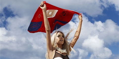 Sky, Flag, Cloud, People in nature, Jewellery, Carmine, Photography, Cumulus, Long hair, Wind,