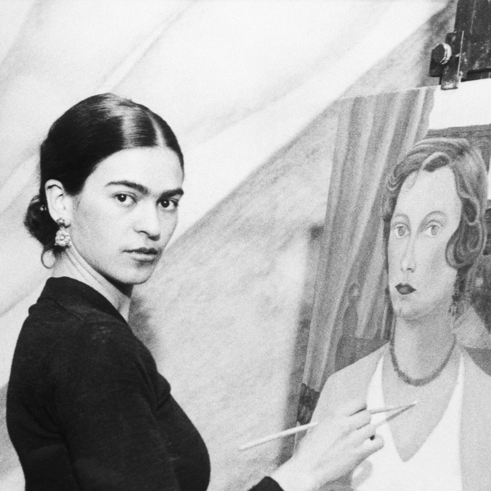 22 Jan 1931 --- Original caption: 1/22/1931- Even though her famous husband sits by and declines to comment on her art ambitions, Mrs. Diego Rivera, wife of the famous Mexican artist, can and does, do very passable portraits. Photo shows Mrs. Diego Rivera painting one now, and she is doing a mural for the San Francisco Stock Exchange, with one of her portraits of a San Francisco society woman. --- Image by © Bettmann/CORBIS