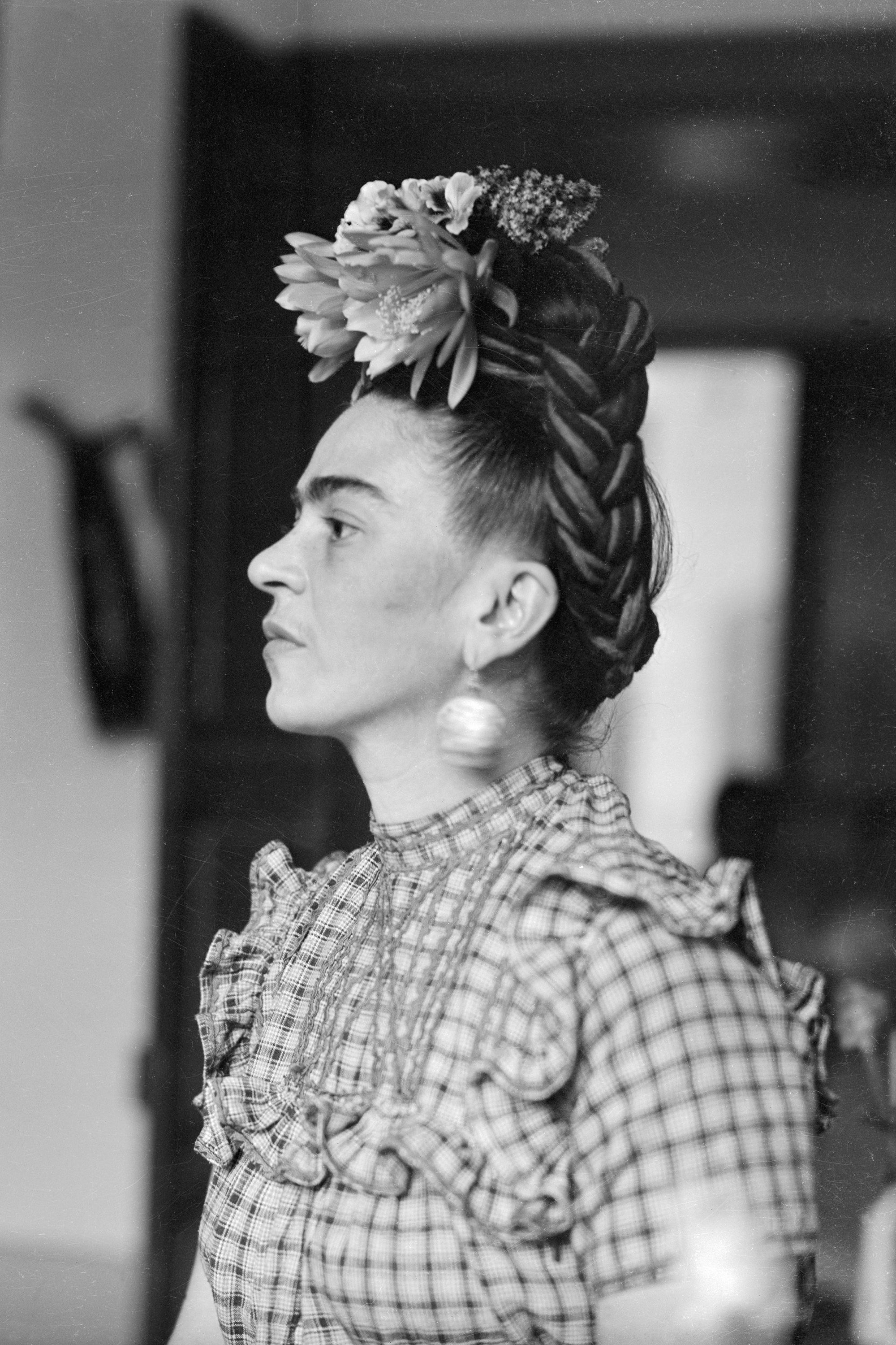 1944 --- Original caption: Frida Kahlo, (1910-1954), Mexican painter and wife of Diego Rivera is shown in this head and shoulders photograph. --- Image by © Bettmann/CORBIS