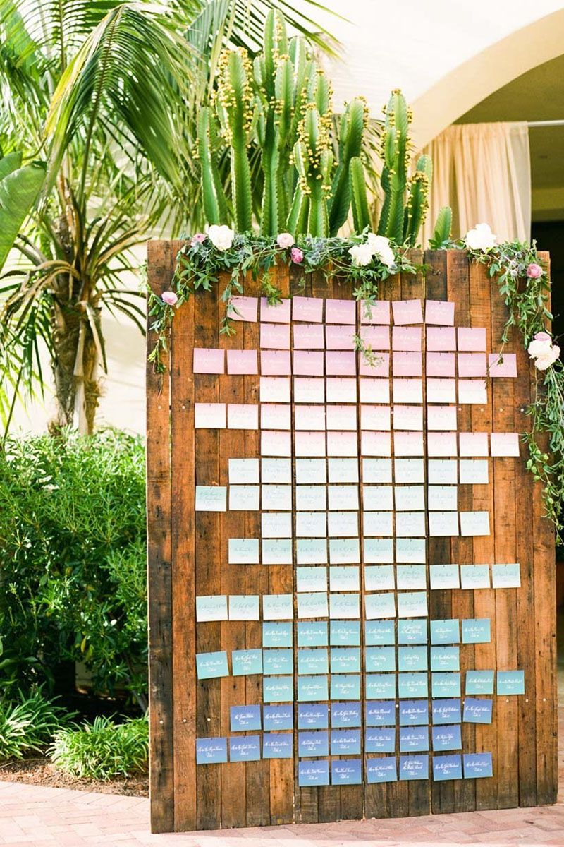 If you're going to have simple, solid colored escort cards, why not arrange them in a beautiful ombre?