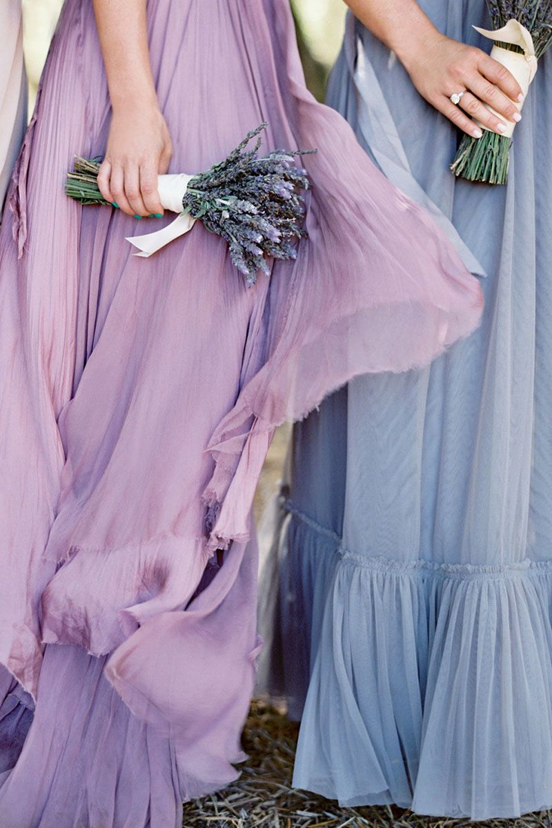 Simple lavender bouquets look rustic and sweet against a subtle gradient of different shades of lavender dresses.