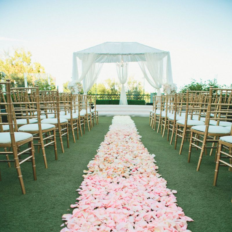 Have you ever seen anything more romantic than this soft pink aisle of petals, leading to the white curtained chuppah at the end?