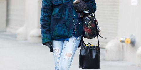 Sleeve, Bag, Textile, Outerwear, Jacket, Street fashion, Fashion, Leather, Electric blue, Camera,