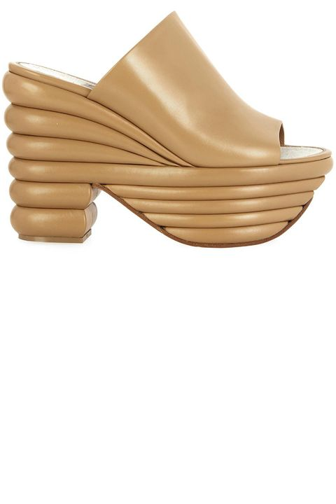 "<strong>Salvatore Ferragamo</strong> shoes, $1,277, <a target=""_blank"" href=""http://www.matchesfashion.com/us/products/Salvatore-Ferragamo-Miley-leather-wedge-mules-1008181"">matchesfashion.com</a>."
