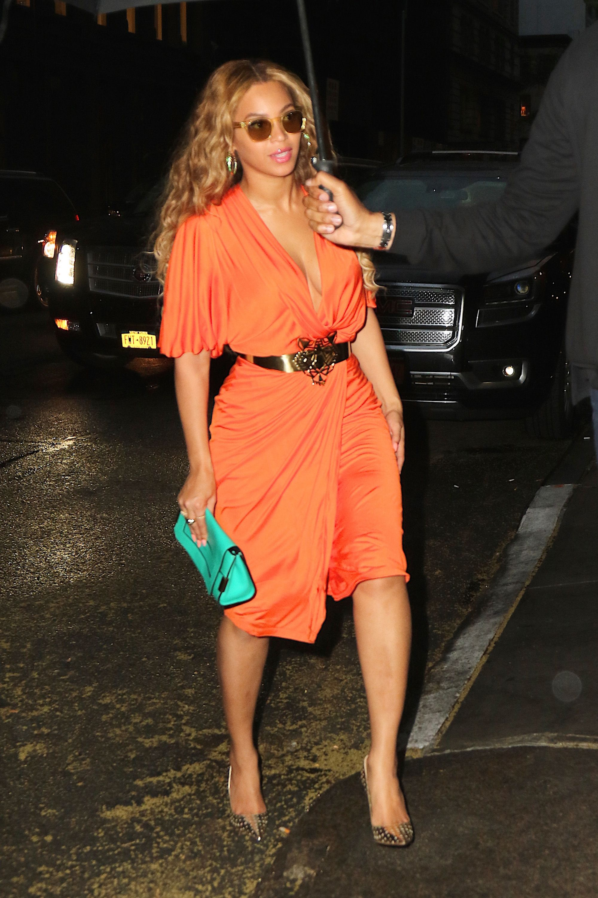 27 May 2015, New York City, New York State, USA --- EXCLUSIVE: Beyonce and Jay-Z leave their NYC office together following their recent vacation to Florence, Italy. Beyonce wore a bright orange dress cinched with a gold belt in the shape of a tiger's head with gold heels to match, and accessorized with a teal clutch and gold shades. The power couple were both in high spirits as they left smiling before heading to dinner in the West Village. Pictured: Beyonce --- Image by © We Dem Boyz/Splash News/Corbis