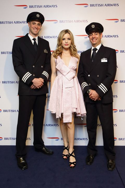 KUALA LUMPUR, MALAYSIA - MAY 28:  Georgia May Jagger (C) is flanked by British Airways' pilots Matt Brazenor (L) and Andy Fonseca (R) during British Airways Kuala Lumpur launch event on May 28, 2015 in Kuala Lumpur, Malaysia.  (Photo by Suhaimi Abdullah/Getty Images for British Airways)