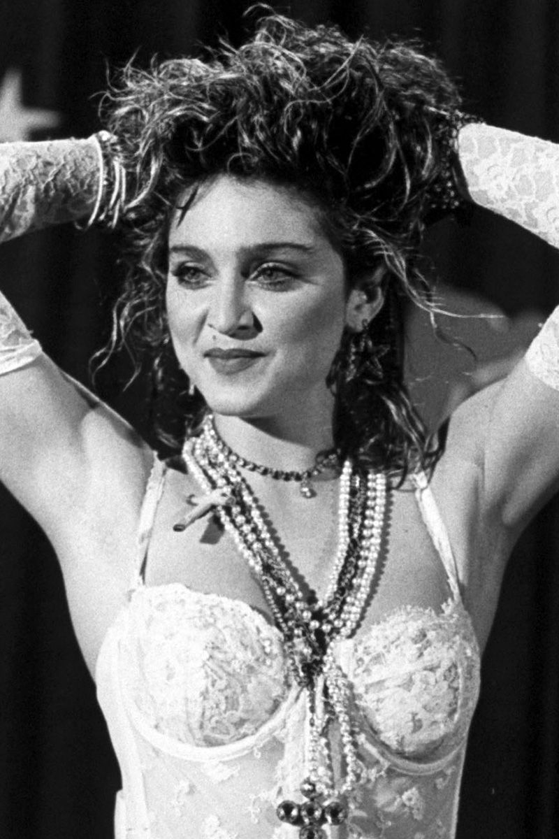 American singer and actress Madonna wearing white lace lingerie, pearls and a Boy Toy belt and standing with her arms raised to her head at 1st annual MTV Video Music Awards, at Tavern on the Green, 1984.  (Photo by David Mcgough/DMI/The LIFE Picture Collection/Getty Images)