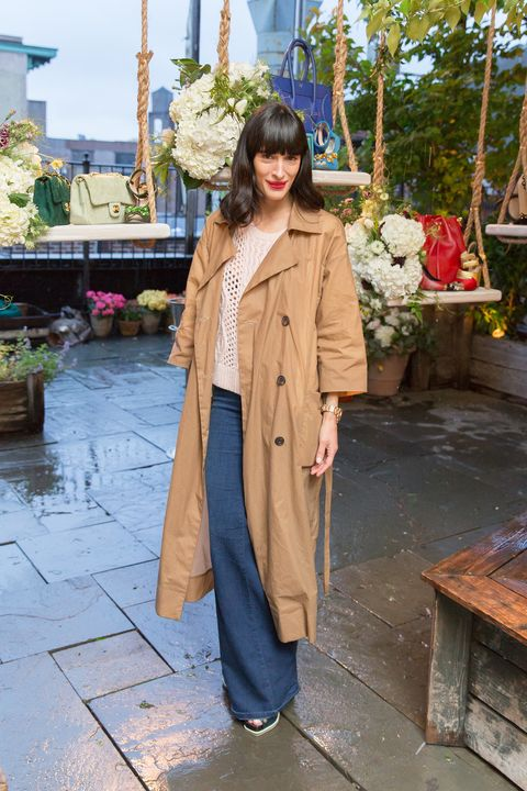 Textile, Coat, Flowerpot, Temple, Street fashion, Overcoat, Beige, Fur, Flower Arranging, Trench coat,