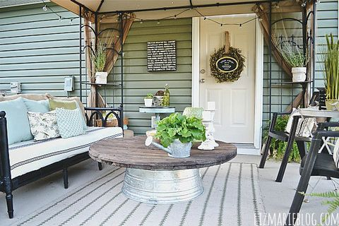 """For an outdoor living room that won't mind weathering the elements, flip over a galvanized tub and top it with a thrfited table top, or a wooden electric spool (as seen here).  <a target=""""_blank"""" href=""""http://www.lizmarieblog.com/2013/07/diy-wire-spool-metal-tub-coffee-table/""""><em>See more at Liz Marie »</em></a>"""