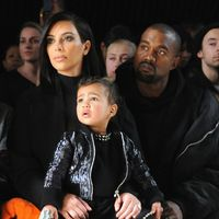 She'll teach her new brother or sister how to steal the show from the front row—cute outfit and fashionable gaze included.