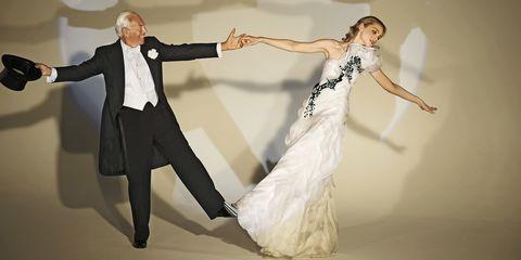 Trousers, Coat, Dress, Formal wear, Performing arts, Suit, Suit trousers, Dancer, Dance, One-piece garment,