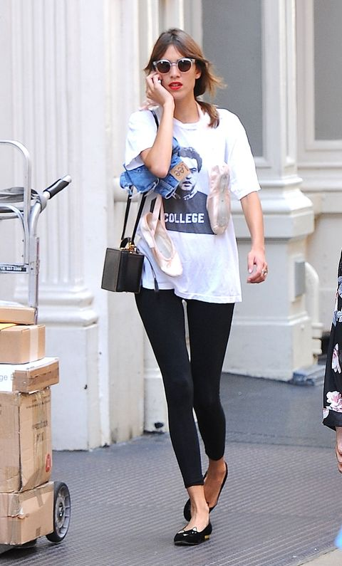 Always one for a retro look, Chung styles her white T-shirt cheekily plastered with John Belushi in <em>Animal House</em> by looking to an Audrey Hepburn-beloved pairing: matching black leggings and ballet flats. It's casual, yet totally idiosyncratic-chic.